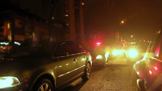 Night street - police cars waiting on city winter road