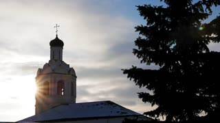 Orthodox church at winter sunset, Russia, time-lapse