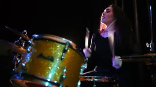 Passionate girl percussion drummer perform music break down - teen rock music, slow motion
