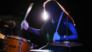 Passionate girl with long hair - percussion drummer perform music break down - teen rock music, slow motion