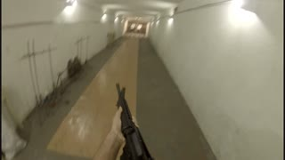POV of a Male Shooter Firing Rounds at a Target with an AR-15 Assault Rifle