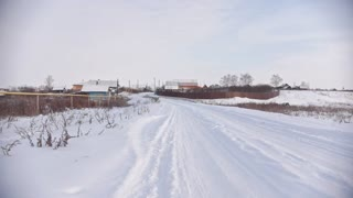 Russian winter village - countryside in center of Volga, snow cold day
