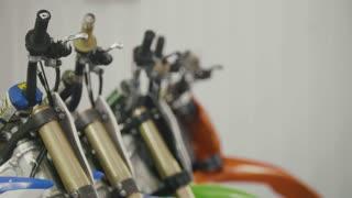 Several motorcycle in the garage - handlebars of enduro cross motorbike