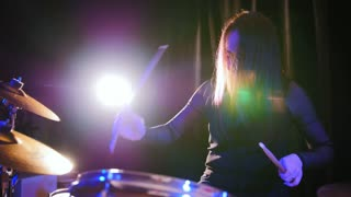 Teen rock music - attractive girl percussion drummer perform music break down