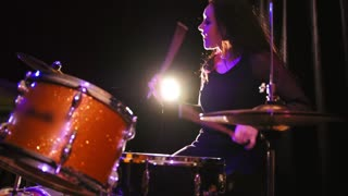 Teen rock music - gothic girl percussion drummer perform music break down