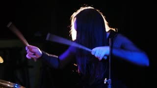 Teen rock music - passionate girl with long hair - percussion drummer perform music break down