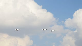 Three small airplanes for agricultural industry flying in the sky