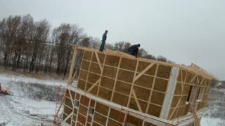 Time-lapse of construction house of straw bales. Installation of walls on the second floor