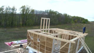 Time-lapse of construction house of straw bales . Workers make the ceiling on the second floor
