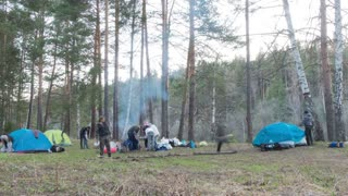 Time Lapse of setting up turistic camping at evening forest, Russia