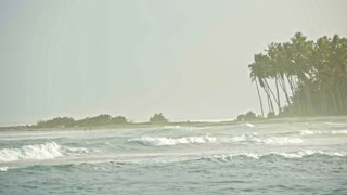 Tropical beach with big waves in slow-motion, telephoto, Dominican Republic