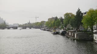Vessels and houseboats along Amstel canals, Amsterdam, Netherlands