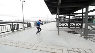 A free run - teenager jumps a flip at park, parkour, slow motion