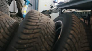A lot of luxury tires in car service for repairing - mechanical workshop