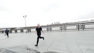 A tracer jumps street acrobatic parkour, slow-motion