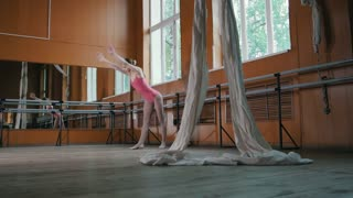 A young girl gracefully performs acrobatics