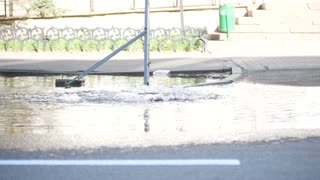 Accident water supply system water flows over the road from manhole