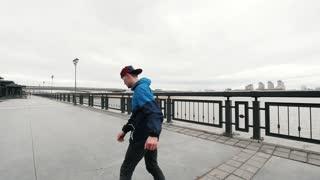 Acrobatic parkour teenager doing backflip - slow motion