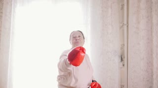 An old senior woman boxing