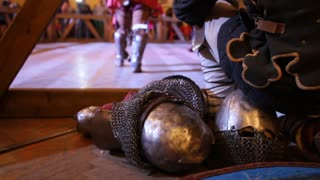 Armor and helmet at Fighting of knights - iron chain armour near arena