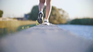 Athletic Girl Walking Near The River In Sneakers