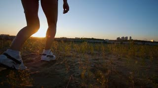 Athletic Young Woman Runs To The River And Looks At The Sunset