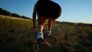 Athletic Young Woman Runs Up