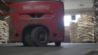 Autoloader loading goods in industrial warehouse
