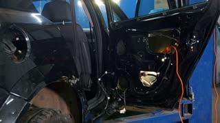 Automobile diagnostic service - mechanics working - car for repairing