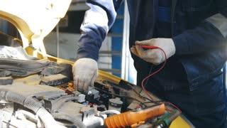 Automotive electrician - automobile service diagnostics, checking electro fuse relay in car, small business