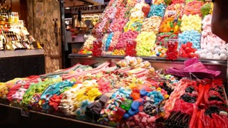 Barcelona, Spain - September 2018, - Many colorful sweets in candy shop setout at the bazar
