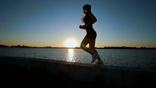 Beautiful Athletic Woman Running On The Waterfront