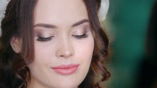 Beautiful brunette model with fashion wedding makeup and hairstyle