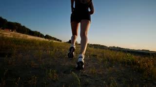 Beautiful Girl Running On The Grass