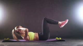 Blonde attractive blonde woman exercising - training for abdominal