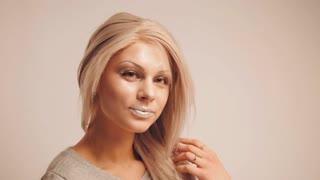 Blonde model posing for photographer in studio