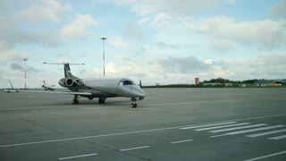 Business jet - small passenger aircraft plane at the airport runway