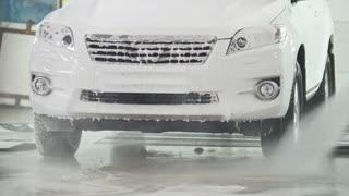 Car washing - a SUV car in the suds - car service