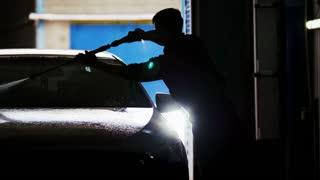 Car washing in workshop - silhouette