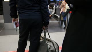 Check-in in the airport - passengers standing in queue