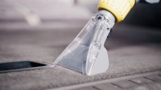 Close up of - cleaning of vehicle wardrobe with vacuum cleaner