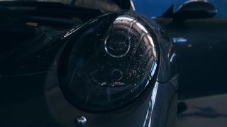 Close up view of headlights of luxury sport car - auto service checking