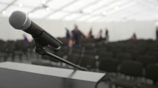 Conference of lecture - microphone on stage in auditorium waiting for performances, close up