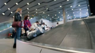 Conveyer belt with luggage at the airport