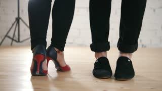 Couples dancing salsa or kizomba in studio - legs, close up