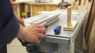 Craftman hand working working with a screwdriver using joinery equipment in workshop