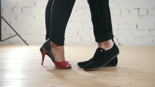 Dancers feet - family couple is dancing kizomba in studio
