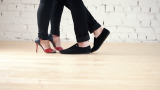 Dancers feet wearing fashion shoes - family couple is dancing kizomba in studio