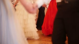 Dancing young people at the historical ball holding hands, slow-motion