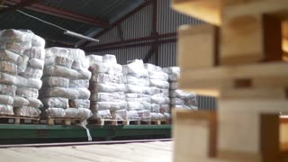 Different bags and boxes inside a storage food warehouse